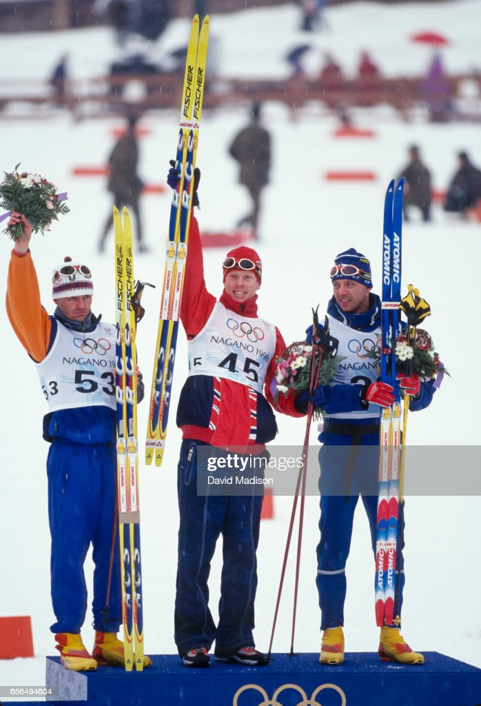 Markus Gandler #53 of Austria (Silver Medal), Bjoern Daehlie #45 of Norway (Gold Medal), and Mika Myllylae of Finland (Bronze Medal) celebrate following the Men's 10 Kilometer Classical event of the Nordic Skiing competition at the 1998 Winter Olympics held on February 12, 1998 at the Snow Harp venue in Hakuba near Nagano, Japan.