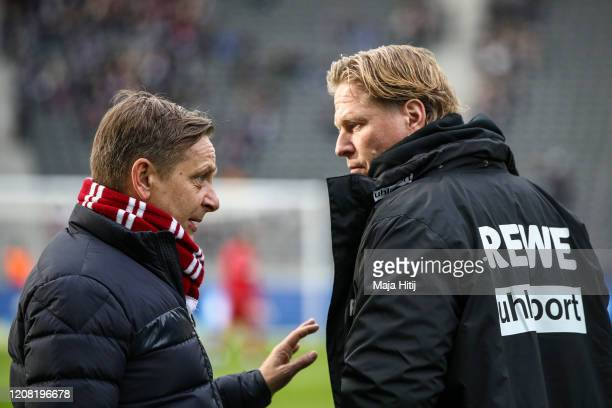 Markus Gisdol, Head Coach of 1. FC Koeln and Horst Heldt , Managing Director Sport of 1. FC Koeln talk prior to the Bundesliga match between Hertha...