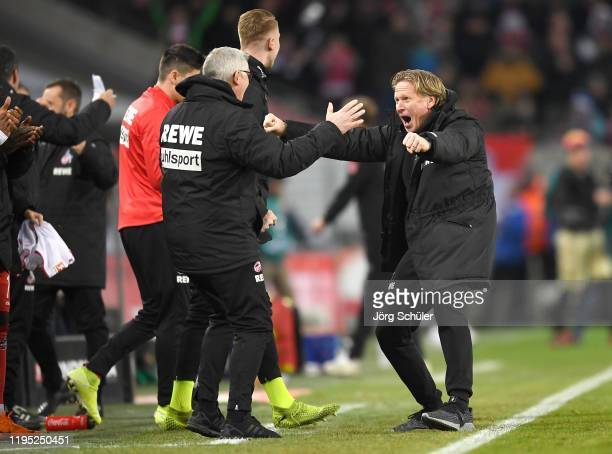 Markus Gisdol, Head Coach of 1. FC Koeln celebrates at full-time after the Bundesliga match between 1. FC Koeln and SV Werder Bremen at...