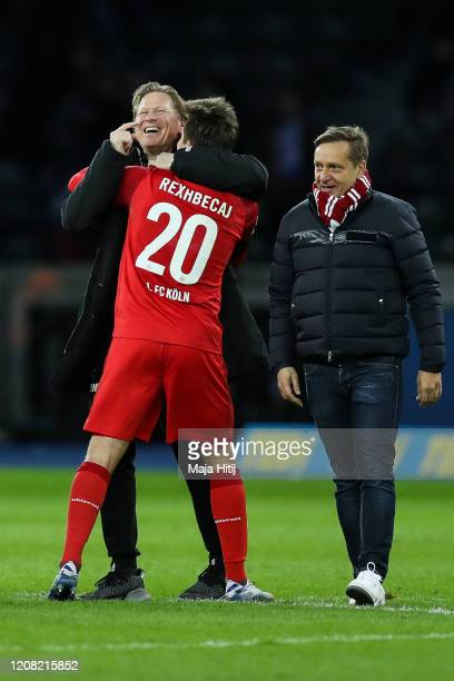 Markus Gisdol, Head Coach of 1. FC Koeln celebrates with Elvis Rexhbecaj of 1. FC Koeln after the Bundesliga match between Hertha BSC and 1. FC Koeln...