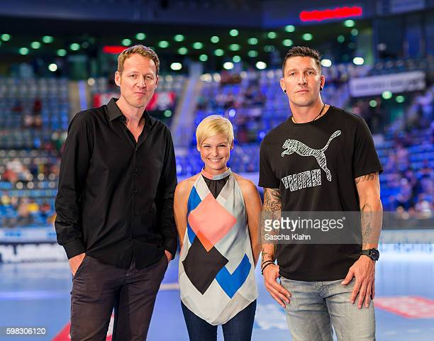 Markus Goetz Anett Sattler and Stefan Kretzschmar of Sport1 at the Pixum Super Cup 2016 between RheinNeckar Lwen and SC Magdeburg at Porsche Arena on...