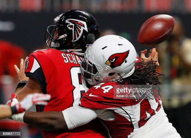 Markus Golden of the Arizona Cardinals forces a fumble as he sacks Matt Schaub of the Atlanta Falcons at MercedesBenz Stadium on August 26 2017 in...