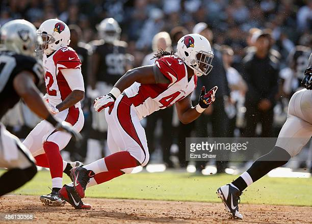 Markus Golden of the Arizona Cardinals in action against the Oakland Raiders at Oco Coliseum on August 30 2015 in Oakland California