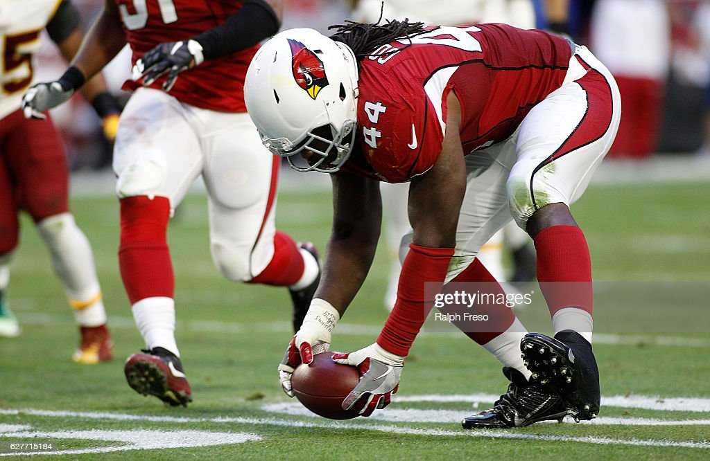 Markus Golden #44 of the Arizona Cardinals picks up a fumble by quarterback Kurk Cousins #8 of the Washington Redskins during the third quarter of a game at University of Phoenix Stadium on December 4, 2016 in Glendale, Arizona. The Cardinals defeated the Redskins 31-23.