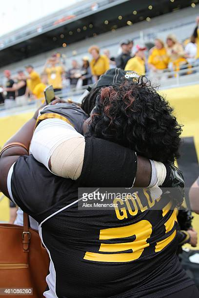 Markus Golden of the Missouri Tigers hug his mother Rhonda after winning the Buffalo Wild Wings Citrus Bowl between the Minnesota Golden Gophers and...