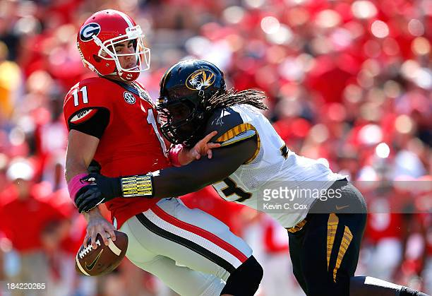 Markus Golden of the Missouri Tigers sackes Aaron Murray of the Georgia Bulldogs at Sanford Stadium on October 12 2013 in Athens Georgia