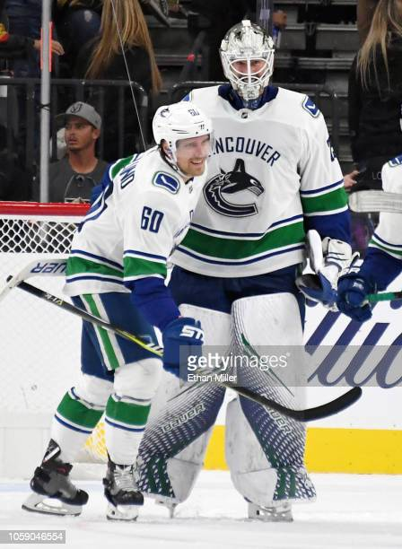 Markus Granlund and Jacob Markstrom of the Vancouver Canucks celebrate after the team's 32 shootout victory over the Vegas Golden Knights at TMobile...