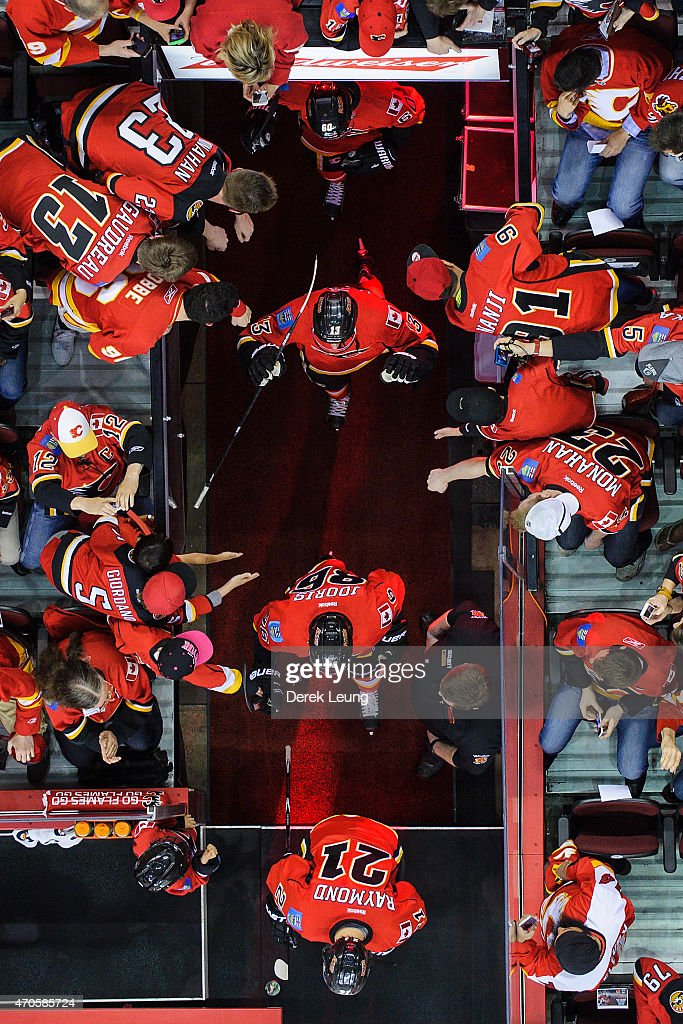 Markus Granlund #60, Johnny Gaudreau #13, Josh Jooris #86 and Mason Raymond #21 of the Calgary Flames come out for warm-ups prior to Game Four of the Western Quarterfinals against the Vancouver Canucks during the 2015 NHL Stanley Cup Playoffs at Scotiabank Saddledome on April 21, 2015 in Calgary, Alberta, Canada.