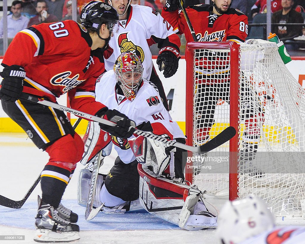 Markus Granlund #60 of the Calgary Flames scores against Craig Anderson #41 of the Ottawa Senators during an NHL game at Scotiabank Saddledome on November 15, 2014 in Calgary, Alberta, Canada. The Flames defeated the Senators 4-2.