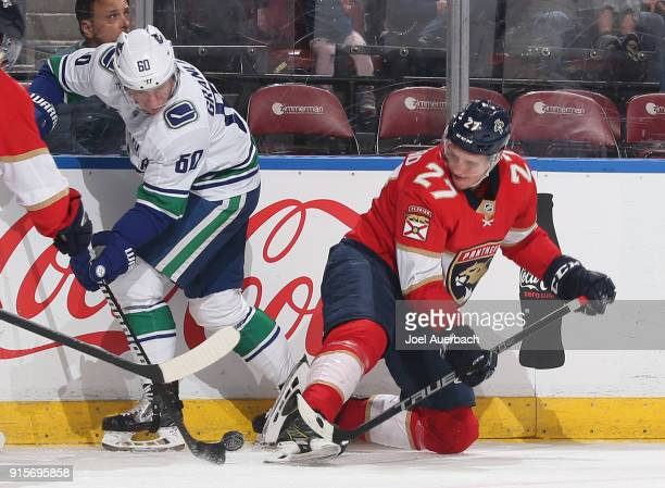 Markus Granlund of the Vancouver Canucks and Nick Bjugstad of the Florida Panthers battle along the boards for possession of the puck at the BBT...