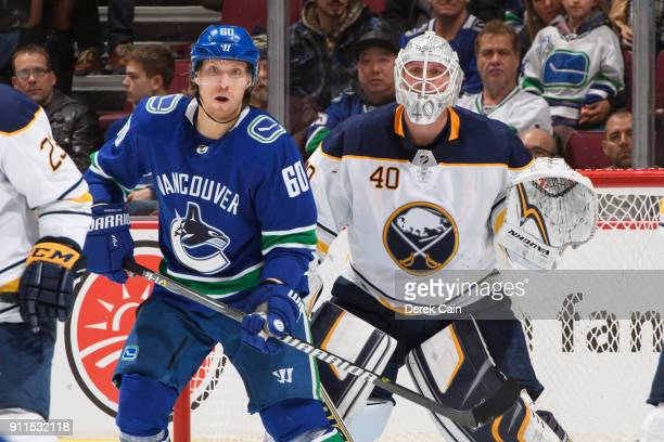 Markus Granlund of the Vancouver Canucks and Robin Lehner of the Buffalo Sabres watch the play during their NHL game against the Vancouver Canucks at...
