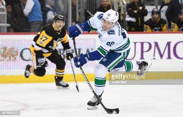 Markus Granlund of the Vancouver Canucks attempts a shot in the first period during the game against the Pittsburgh Penguins at PPG PAINTS Arena on...