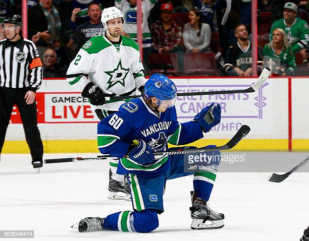 Markus Granlund of the Vancouver Canucks celebrates in front of Dan Hamhuis of the Dallas Stars after scoring in overtime during their NHL game at...