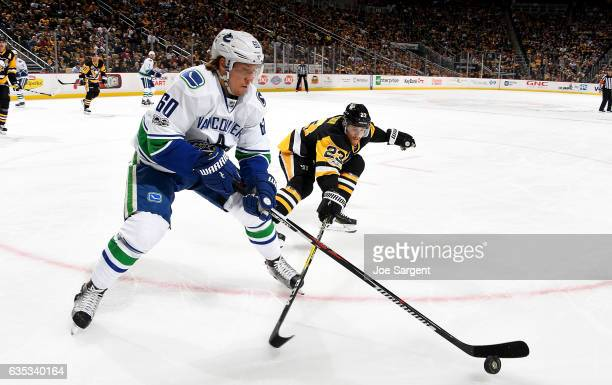 Markus Granlund of the Vancouver Canucks handles the puck in front of Scott Wilson of the Pittsburgh Penguins at PPG Paints Arena on February 14 2017...