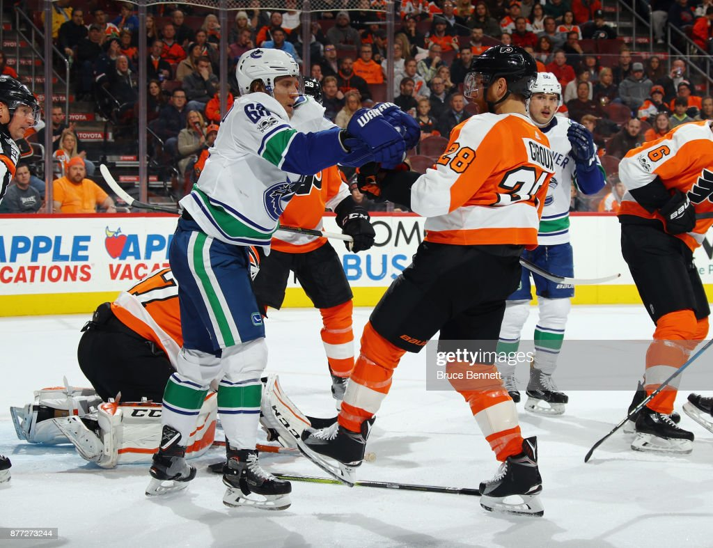 Markus Granlund #60 of the Vancouver Canucks hits Claude Giroux #28 of the Philadelphia Flyers during the third period at the Wells Fargo Center on November 21, 2017 in Philadelphia, Pennsylvania. The Canucks defeated the Flyers 5-2.