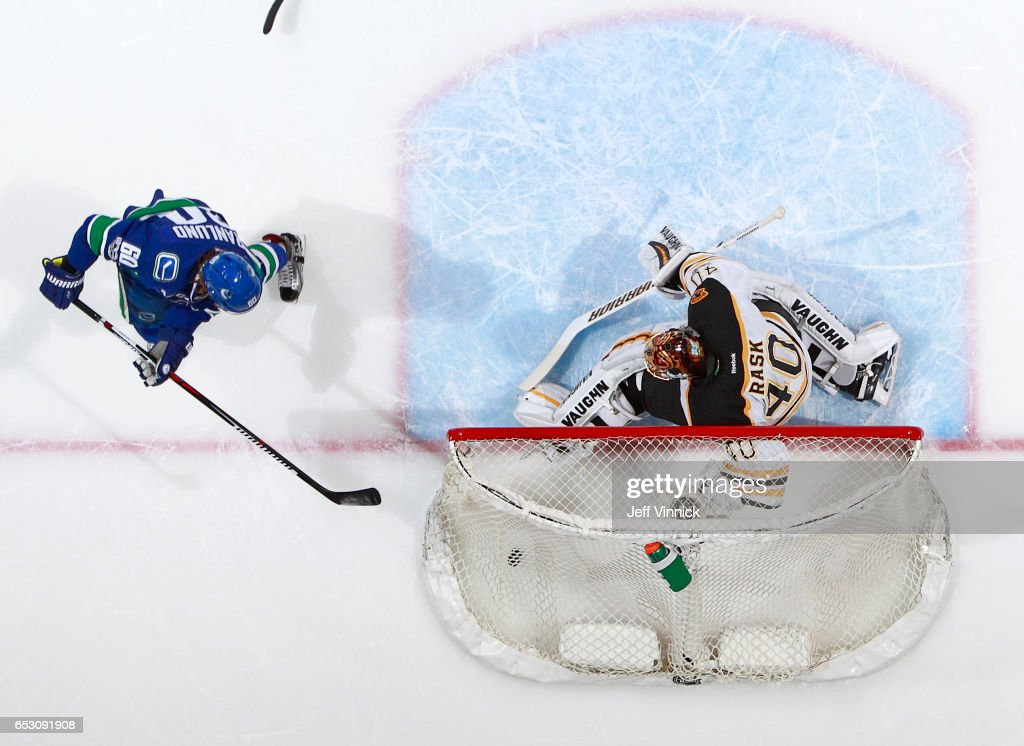 Markus Granlund #60 of the Vancouver Canucks scores on Tuukka Rask #40 of the Boston Bruins during their NHL game at Rogers Arena March 13, 2017 in Vancouver, British Columbia, Canada. Boston won 6-3.