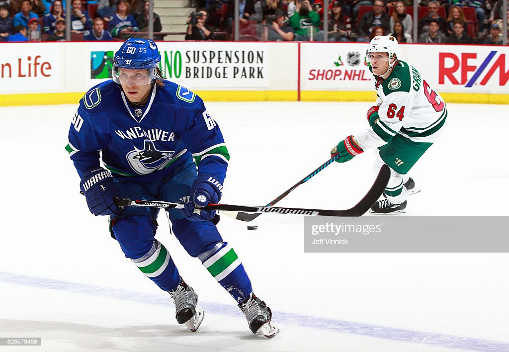Markus Granlund #60 of the Vancouver Canucks skates up ice as his brother Mikael Granlund #64 of the Minnesota Wild skates up ice behind him with the puck during their NHL game at Rogers Arena November 29, 2016 in Vancouver, British Columbia, Canada. Vancouver won 5-4.