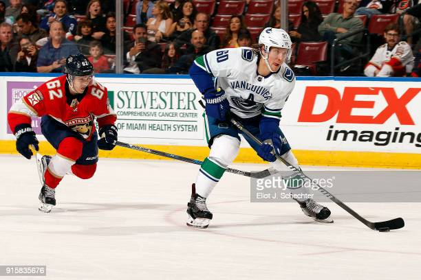 Markus Granlund of the Vancouver Canucks skates with the puck against Denis Malgin of the Florida Panthers at the BBT Center on February 6 2018 in...