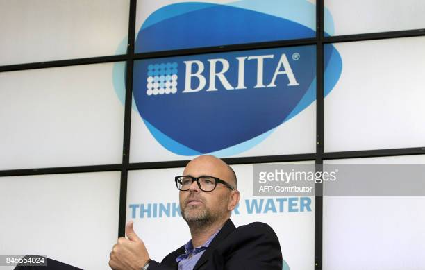 Markus Hankammer CEO of German water filtration company Brita is pictured at the company's headquarter in Taunusstein Germany on August 16 2017 / AFP...