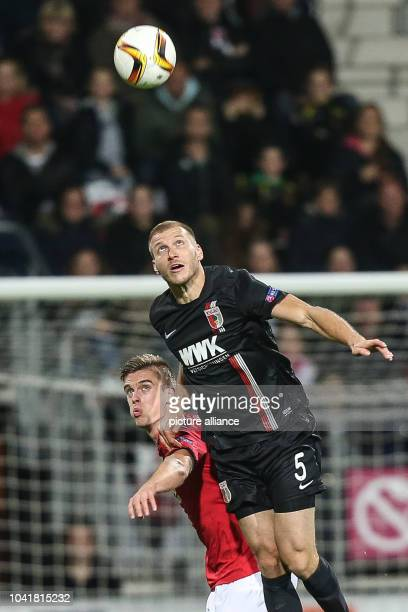 Markus Henriksen from Alkmaar and Ragnar Klavan from Augsburg fight for the ball during the UEFA Europa League Group L soccer match between AZ...