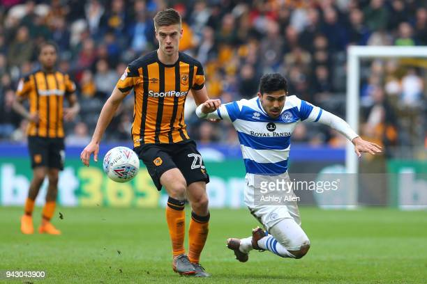 Markus Henriksen of Hull City battles for control of the ball with Massimo Luongo of Queens Park Rangers during the Sky Bet Championship match...