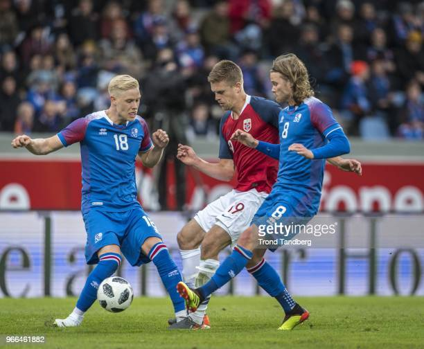 Markus Henriksen of Norway Horour Magnusson Birkir Bjarnason of Iceland during International Friendly between Iceland v Norway at Laugardalsvollur...