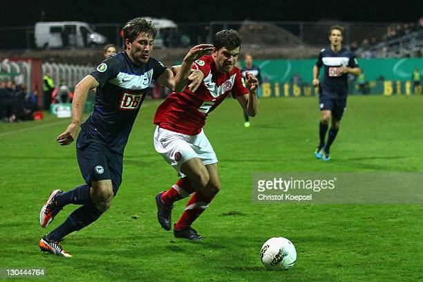 Markus Heppke of Essen challenges Tunay Torun of Berlin during the second round DFB Cup match between RotWeiss Essen and Hertha BSC Berlin at...