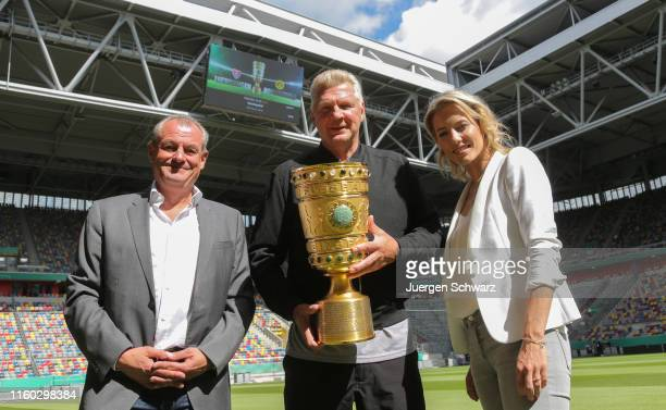 Markus Hoehner, Stefan Effenberg and Laura Papendick pose after news conference prior to the upcoming DFB cup match between KFC Uerdingen and...