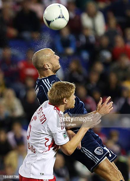 Markus Holgersson of the New York Red Bulls contests a header with Aurelien Collin of Sporting Kansas City at Red Bull Arena on October 20 2012 in...