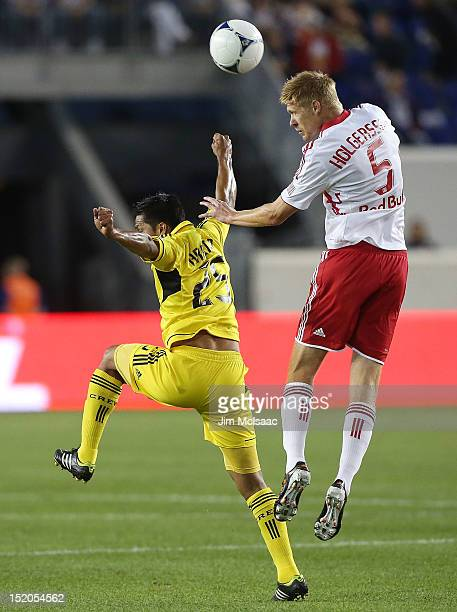 Markus Holgersson of the New York Red Bulls heads the ball against Jairo Arrieta of the Columbus Crew at Red Bull Arena on September 15 2012 in...