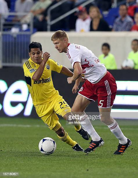 Markus Holgersson of the New York Red Bulls in action against Jairo Arrieta of the Columbus Crew at Red Bull Arena on September 15 2012 in Harrison...
