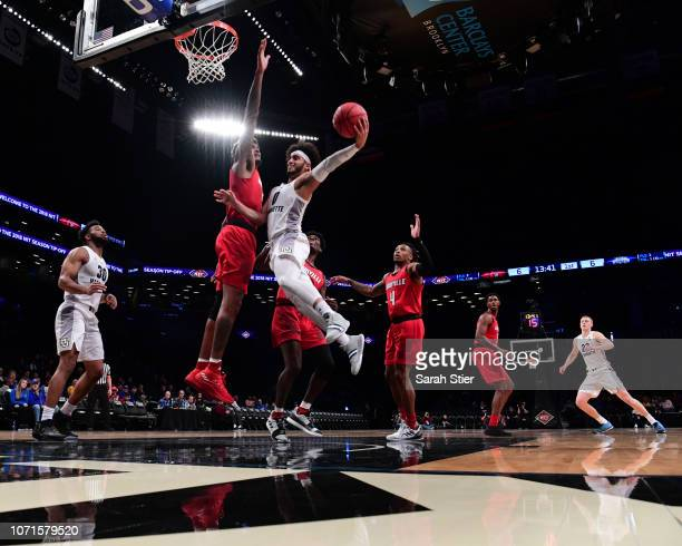 Markus Howard of the Marquette Golden Eagles attempts a layup during the first half of the game against Louisville Cardinals at the NIT Season...