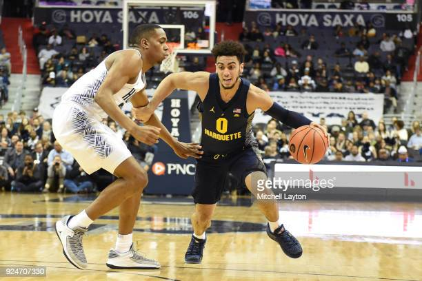Markus Howard of the Marquette Golden Eagles drives against Kaleb Johnson of the Georgetown Hoyas during a college basketball game against the...