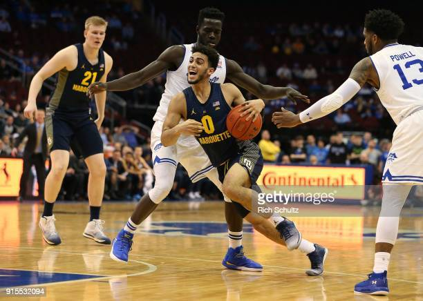 Markus Howard of the Marquette Golden Eagles drives to the basket between Ismael Sanogo and Myles Powell of the Seton Hall Pirates during the first...