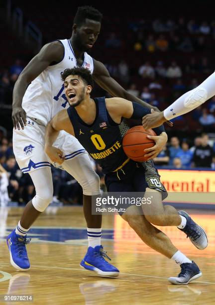 Markus Howard of the Marquette Golden Eagles in action against Ismael Sanogo of the Seton Hall Pirates during a game at Prudential Center on February...