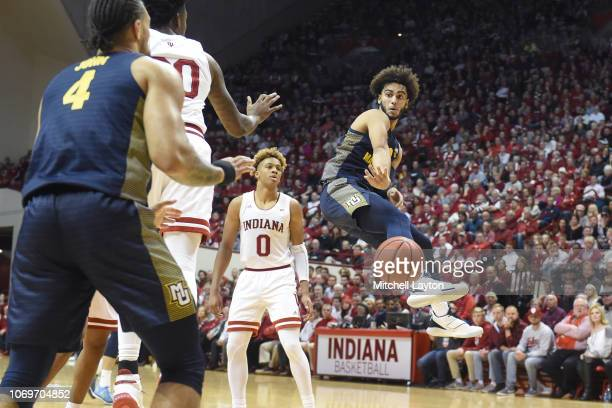 Markus Howard of the Marquette Golden Eagles passes the ball during a college basketball game against the Indiana Hoosiers at the Simon Skjodt...