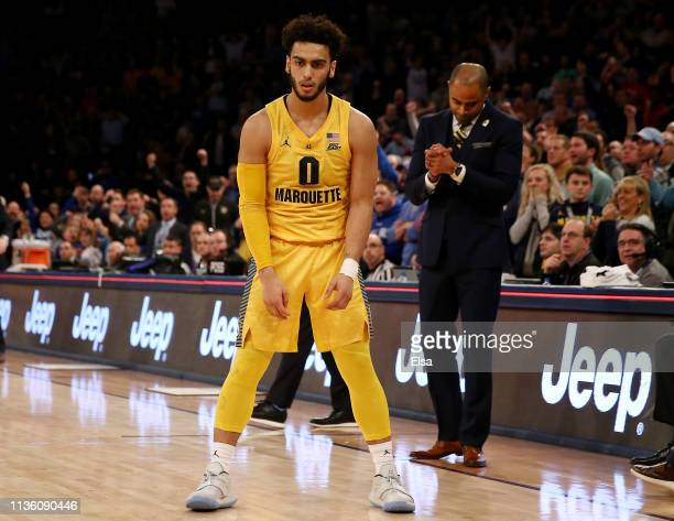 Markus Howard of the Marquette Golden Eagles reacts after missing the shot to tie the game in the final seconds of the game during the semifinal...
