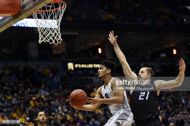 Markus Howard of the Marquette Golden Eagles takes a shot in front of Isaiah Zierden of the Creighton Bluejays during the second half of a game at...
