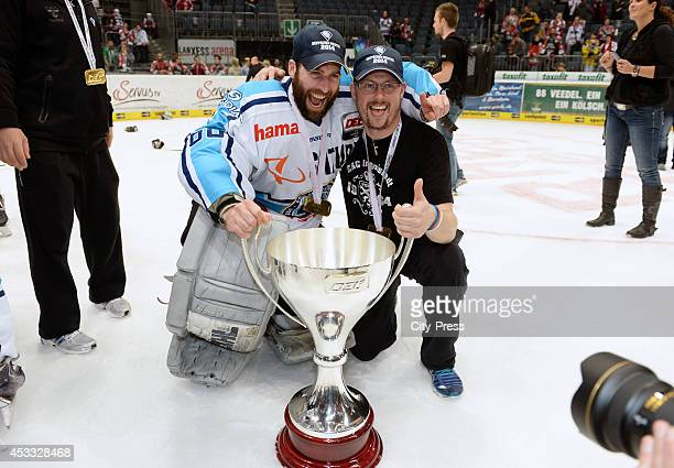 Markus Janka and Michael Klattenbacher after game seven of the DEL playoff final on April 29, 2014 in Cologne, Germany.