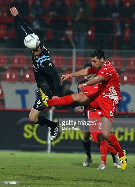 Markus Karl of Berlin and Max Nicu of Muenchen battle for the ball during the Second Bundesliga match between 1.FC Union Berlin and 1860 Muenchen at...