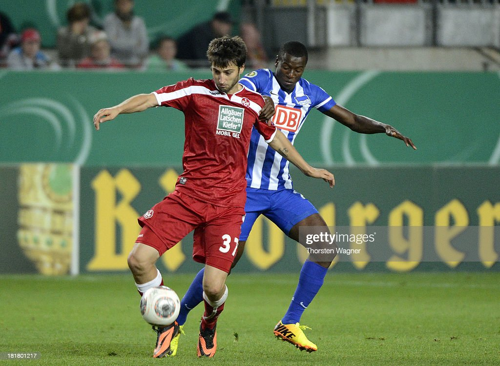 Markus Karl (L) of Kaiserslautern battles for the ball with Adrian Ramos (R) of Berlin during the DFB Cup 2nd round match between 1.FC Kaiserslautern and Hertha BSC Berlin at Fritz-Walter-Stadion on September 25, 2013 in Kaiserslautern, Germany.