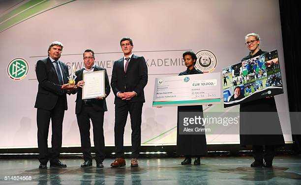 Markus Kauczinski of Karlsruher SC receives the 'Coach of the Year' award from DFB Vice President Ronny Zimmermann and Karlsrue manager Jens Todt...