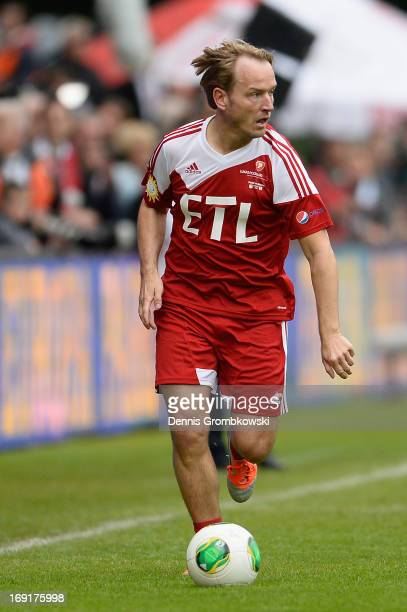 Markus Krampe controls the ball during the Kicken fuer den guten Zweck event at Sportpark Hoehenberg on May 20 2013 in Cologne Germany