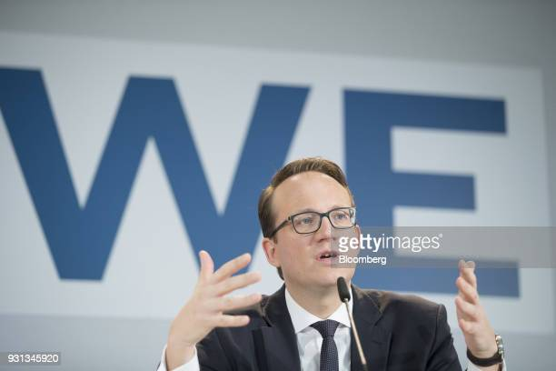 Markus Krebber chief financial officer of RWE AG gestures while speaking during a news conference in Essen Germany on Tuesday March 13 2018 EON SE...