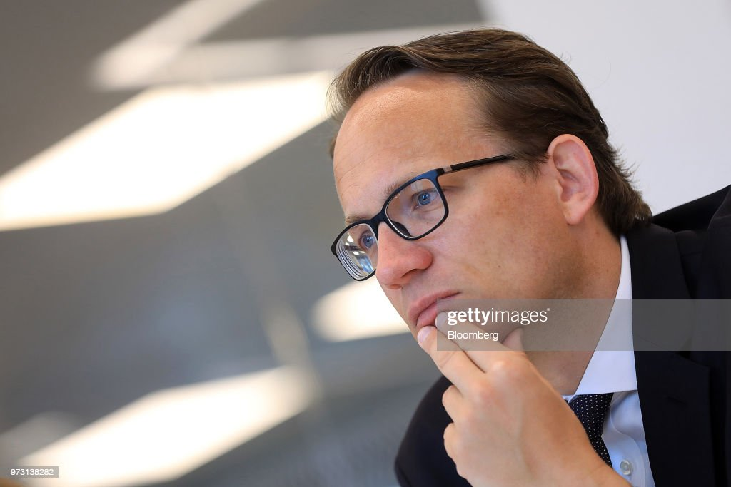 Markus Krebber, chief financial officer of RWE AG, pauses during an interview in Berlin, Germany, on Wednesday, June 13, 2018. Theasset swapannounced this March by RWE AG and EON SE, that separates power generation from grids and retail, will probably be replicated elsewhere in Europe. Photographer: Krisztian Bocsi/Bloomberg via Getty Images