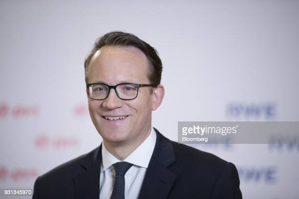 Markus Krebber chief financial officer of RWE AG reacts during a Bloomberg Television interview in Essen Germany on Tuesday March 13 2018 EON SE will...
