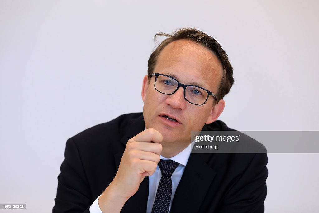 Markus Krebber, chief financial officer of RWE AG, speaks during an interview in Berlin, Germany, on Wednesday, June 13, 2018. Theasset swapannounced this March by RWE AG and EON SE, that separates power generation from grids and retail, will probably be replicated elsewhere in Europe. Photographer: Krisztian Bocsi/Bloomberg via Getty Images