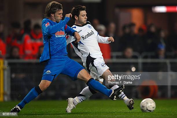 Markus Kroesche of Paderborn and Daniel Halfar of Bielefeld tackle for the ball during the Second Bundesliga match between SC Paderborn and Arminia...