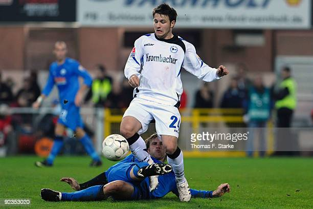 Markus Kroesche of Paderborn tackles Daniel Halfar of Bielefeld during the Second Bundesliga match between SC Paderborn and Arminia Bielefeld at...