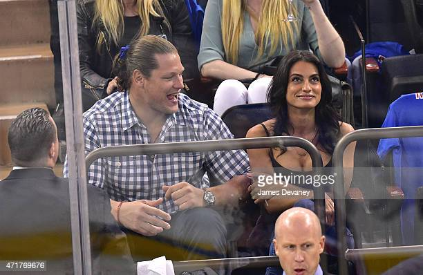 Markus Kuhn and guest attend the Washington Capitals vs New York Rangers playoff game at Madison Square Garden on April 30 2015 in New York City